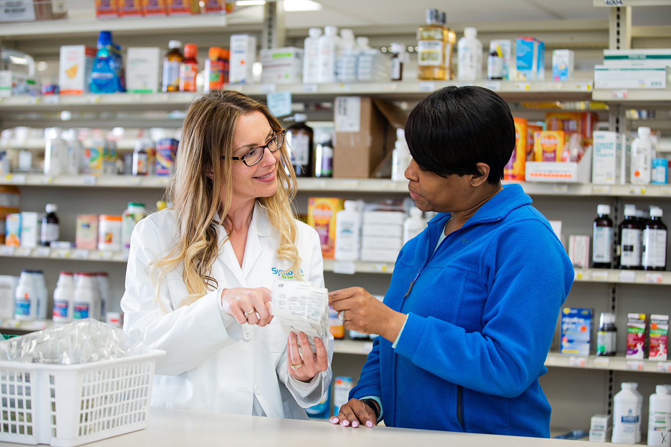 Symbria pharmacist reviews medication with patient