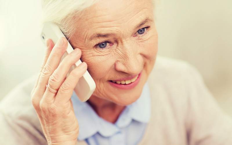 Older patient at home talking with pharmacy